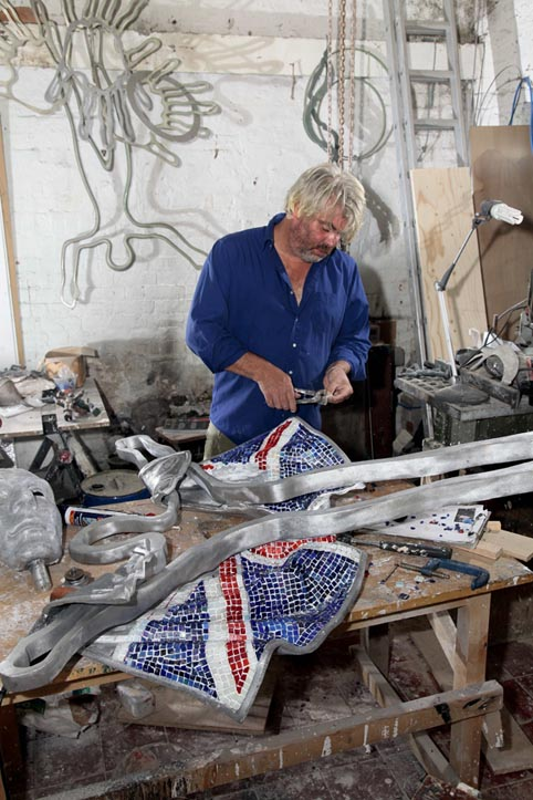 Guy in his studio working on sculpture for the Olympics - photo by Shaun Aiden