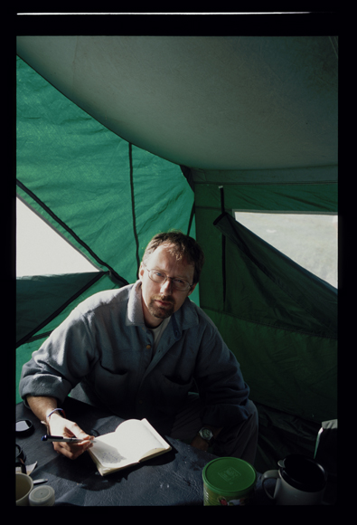 Hugh Thomson author in field tent Peru
