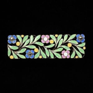 Enamel floral brooch by Bernard Instone, in the collections of the V&A Museum.