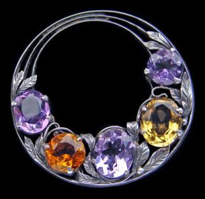 Bernard Instone. Arts and Crafts brooch. Silver, amethyst and citrine. Diameter: 4.1 cm (1.6 in). English, c. 1930. Sold by Tadema Gallery.