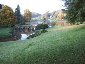 Stourhead. The Palladian Bridge in the foreground and the Pantheon on the other side of the lake.