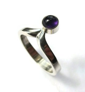 N E From vintage modernist amethyst ring.