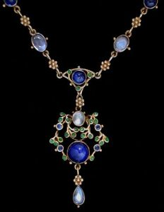 Jessie M King design for Liberty & Co. Gold, sapphire, moonstone and green enamel necklace. Sold by Van Den Bosch.