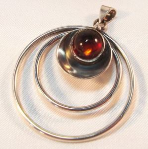 N E From amber pendant.
