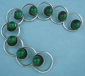 N E From chrysoprase bracelet.