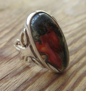 Oval moss agate ring, with a Celtic style sterling silver mount.