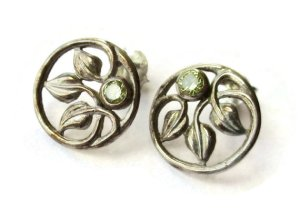 Vintage cecily leaf design peridot glass stud earrings. For sale in my Etsy shop: click on photo for details.