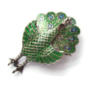 Vintage silver and enamel peacock brooch from Thailand.