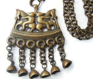 Vintage horse and bear pendant and chain, based on a Viking-period design. Finnish.