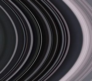 Saturn's rings, photographed by the Cassini orbiter. Photo by NASA, cropped and flipped 180 degrees by me to match my ring.