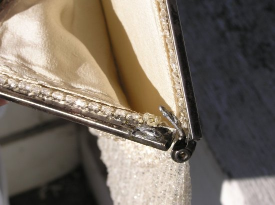 broken hinge on white antique beaded purse