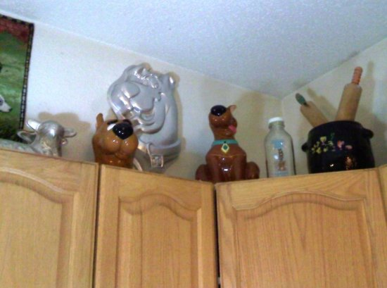 collectibles above cupboards
