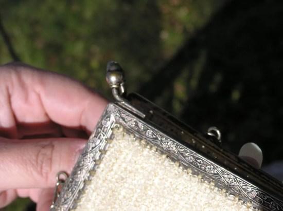 embossed details on silver antique purse frame