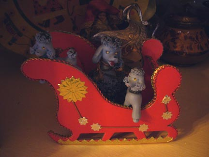 poodles in sleigh