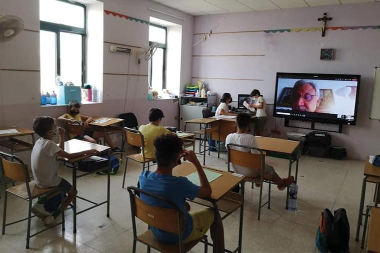 Students of Skolasajf at Marsascala during a poetry writing workshop with author Joseph Portelli.