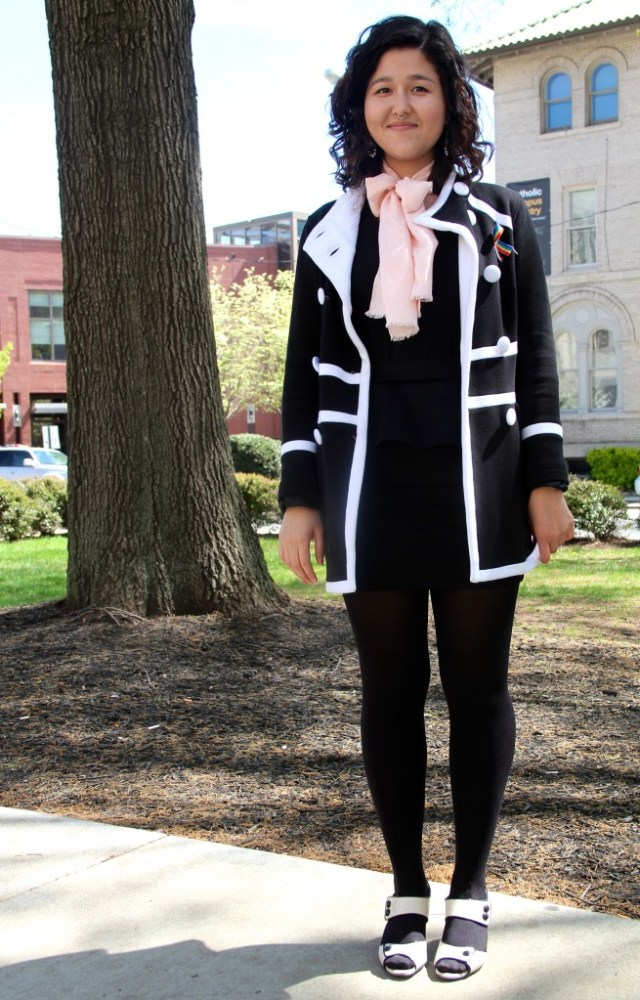 Rachel West, Chemistry major, wearing a coat from Macy's, and hand-me-down shirt, and shoes from DSW.