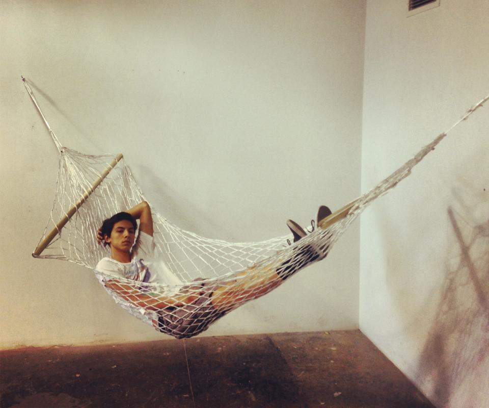 """Hammock"" – (made from plastic bags, the artist is seen using the finished piece in this photo)"