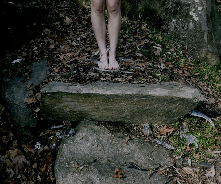 """""""Treedom"""" is a series of photographs depicting roots gathering up a woman's legs. This series represents the idea of escaping and """"planting oneself"""" in solitude, particularly within nature."""