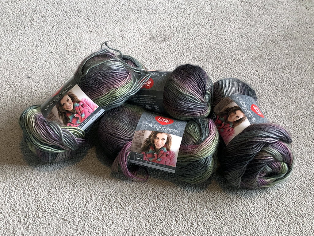 Four balls of Red Heart Unforgettable yarn in the colorway Echo