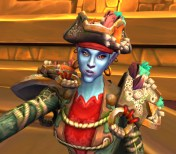 A female troll from World Of Warcraft, mugging in a selfie. She wears a silly tricorn hat and barnacle-encrusted gear. This chick's obviously been to Nazjatar.
