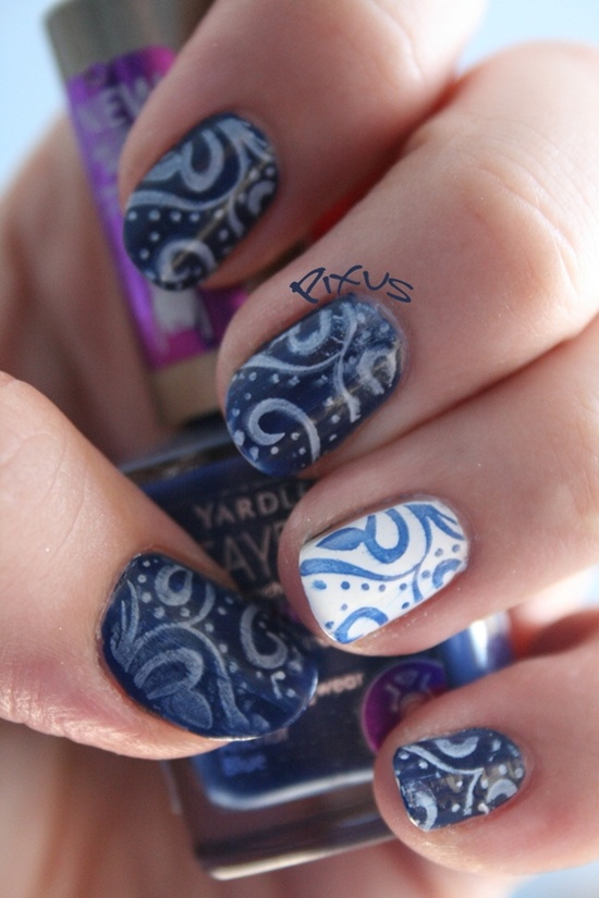 Blue Themed Animal Print Nail Art Design With French Tips
