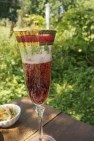 Prosecco with hibiscus flower