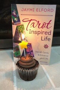 Celebrating the release of my first book Tarot Inspired life with a cupcake and candle.