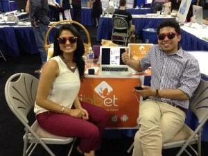 "Virji (left) and Chowdhury of Ribbet at the Innovation Cluster's ""Innovation Zone"" at the LoveLocalPTBO show"