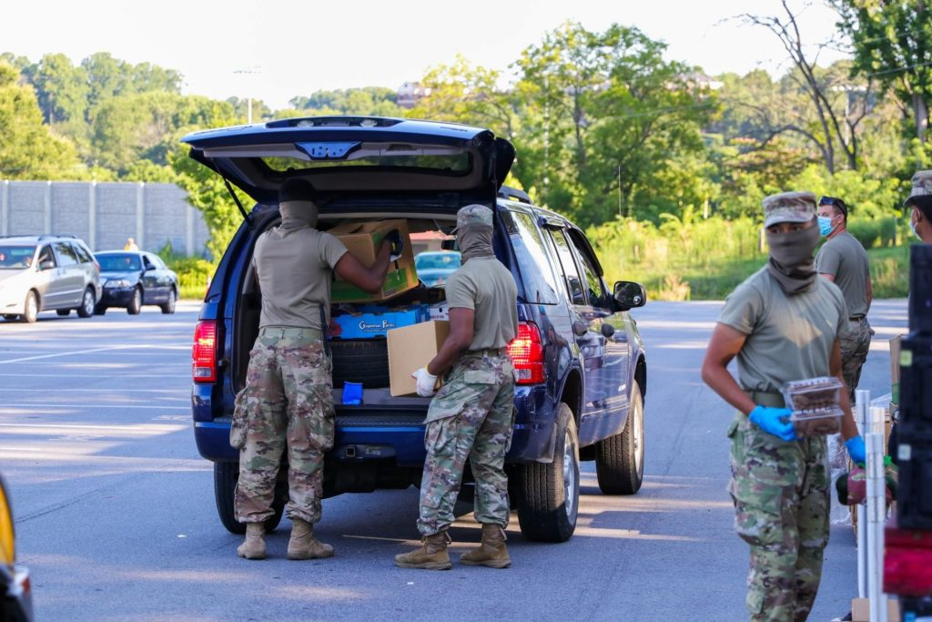 The National Guard distributes meals in parking lot spaces in Innovation Quarter to increase food equity and spatial justice.