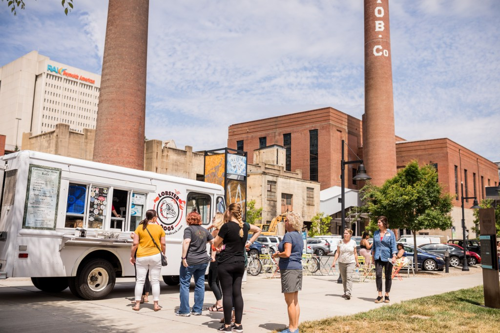People stand in line to order food during Food Truck Friday events.
