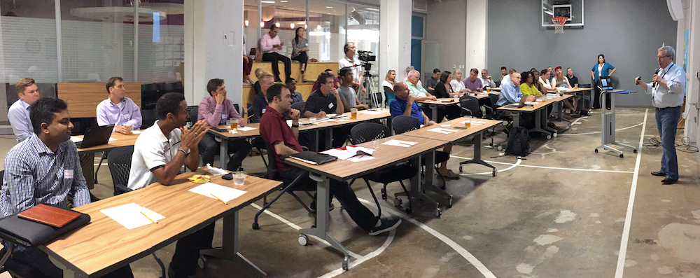 A group of entrepreneurs listen to a talk on startup acceleration during an event hosted in the Innovation Quarter.