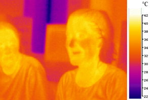 "Image of two people in mid-infrared (""the..."