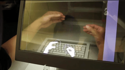 Hand-manipulated objects and transparent displays - the computer desktop of tomorrow?