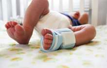 Washable baby bootie doubles as breathing monitor