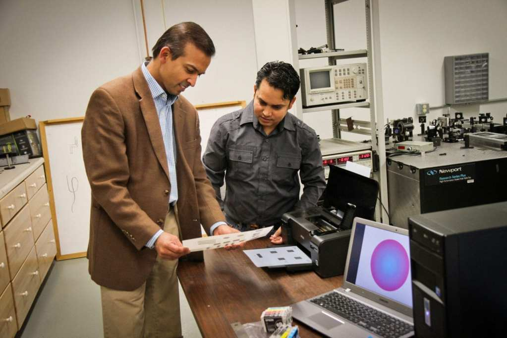 University of Utah electrical engineers Ajay Nahata and Barun Gupta used a $60 inkjet printer with silver and carbon ink cartridges to create a new, widely applicable way to make microscopic structures that use light in metals to carry information. This new technique could be used to rapidly fabricate superfast components in electronic devices, make wireless technology faster or print magnetic materials. Photo Credit: Dan Hixson, University of Utah College of Engineering
