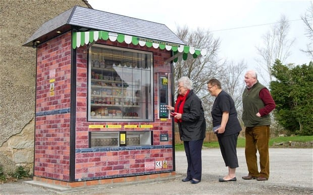 Locals try out the UK's first 'automated shop', which has been installed in the village of Clifton, Derbyshire Photo: Raymonds Press