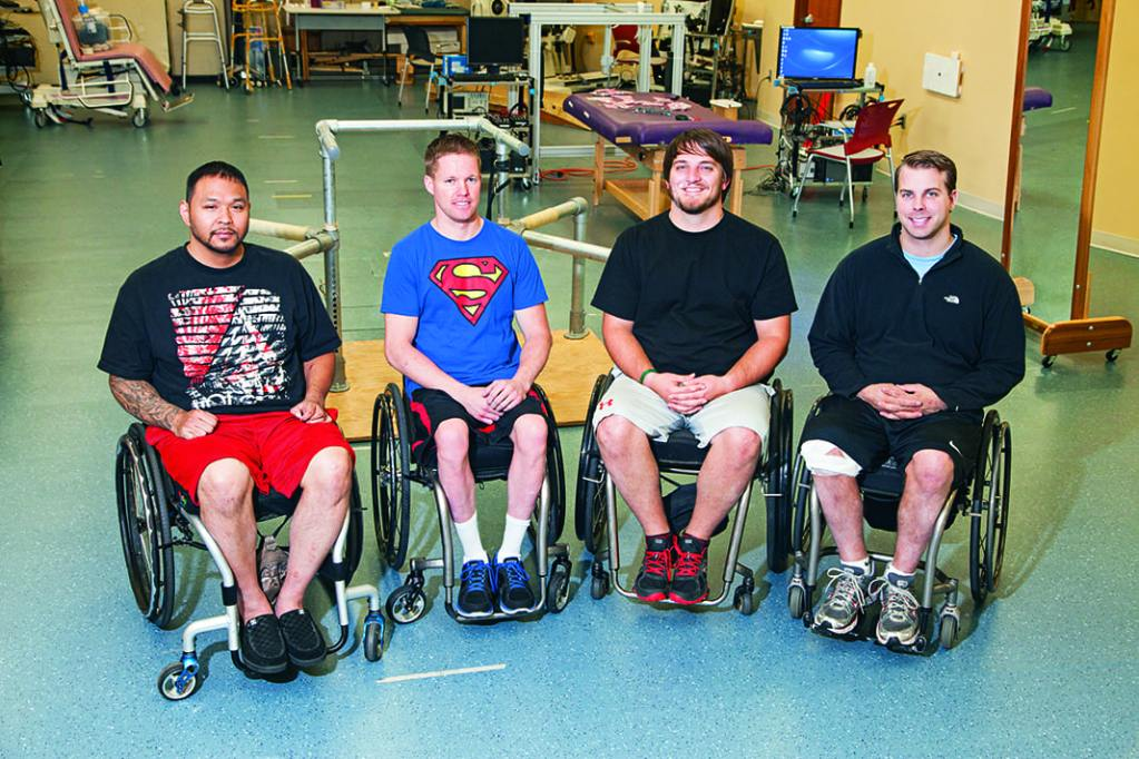 Photos Courtesy of the University of Louisville. Left to right is Andrew Meas, Dustin Shillcox, Kent Stephenson and Rob Summers, the first four to undergo task-specific training with epidural stimulation at the Human Locomotion Research Center laboratory, Frazier Rehab Institute, as part of the University of Louisville's Kentucky Spinal Cord Injury Research Center, Louisville Kentucky.