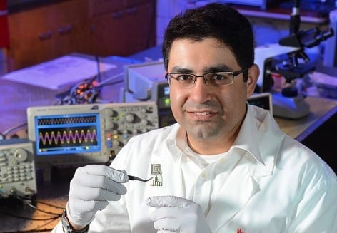 Iowa State's Reza Montazami examines a degradable antenna capable of data transmission. Photo by Bob Elbert.