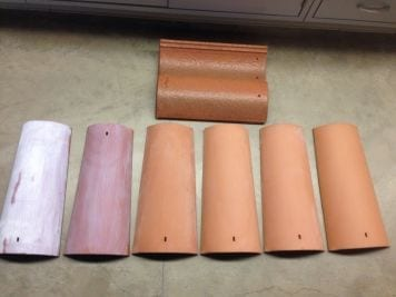 At left, two tiles coated with the titanium dioxide mixture. At right, uncoated tiles. At top, a commercially available tile with titanium dioxide.