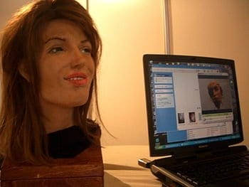 A robot by Human Emulation Robotics. Her facial recognition software makes the interactions eerie. (Photo credit: Wikipedia)