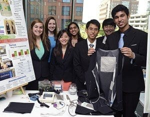 The undergraduates who developed this defibrillator vest included, from left, Quinn Salditch, Caitlin Romanczyk, Melinda Chen, Sandya Subramanian, Ernest So, Billy Kang and Akash Premkumar. Missing from photo: team member Taylor Lam. - Photo: Will Kirk/homewoodphoto.jhu.edu