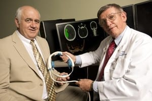 UAMS/UALR Office of Communications UAMS researcher William Culp, M.D., (right), and Doug Wilson of UALR (left) have developed a device to treat stroke