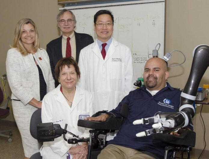 Seated (from left): Dr. Mindy Aisen, chief medical officer at Rancho Los Amigos and patient Erik Sorto. Standing: Dr. Christianne Heck, associate professor of neurology at USC and codirector of the USC Neurorestoration Center; Dr. Richard Andersen, the James G. Boswell Professor of Neuroscience at Caltech; Dr. Charles Y. Liu, professor of neurological surgery, neurology, and biomedical engineering at USC. CREDIT: Lance Hayashida, Caltech