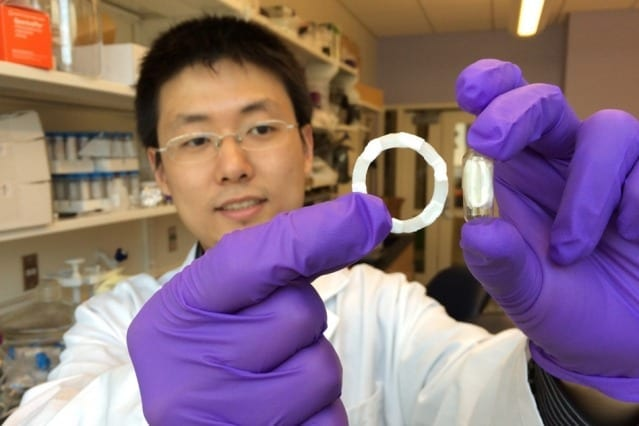 Shiyi Zhang, a postdoc at the Koch Institute and the paper's lead author, holds a ring-shaped device prototype (left), which can be folded into a swallowable capsule (right) for easy and safe oral delivery. Courtesy of the researchers