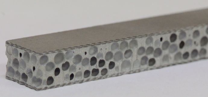 Lightweight metal matrix syntactic foam between two carbon fabric layers, offering extreme light weight, flexibility, and the ability to withstand deformation and absorb energy.