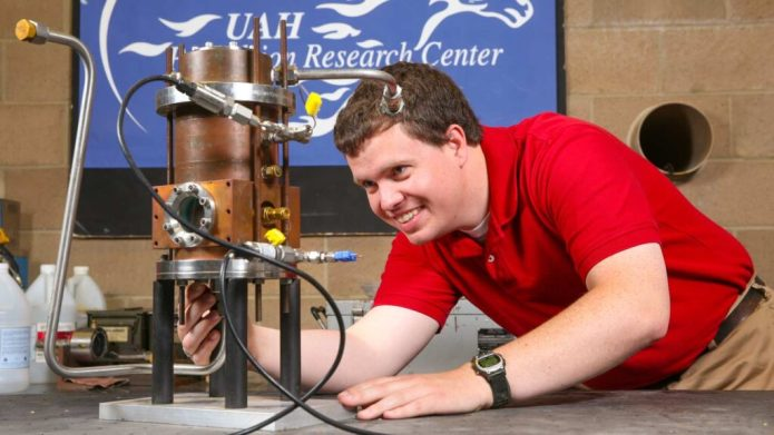 Matthew Hitt, doctoral student in mechanical engineering, is working with a hybrid engine that burns solid and liquid fuels at the same time. His testing is going on in the Johnson Research Center on the UAH campus.