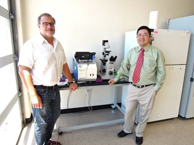 Optokey's Robert Chebi (left) and Frank Chen are commercializing a nanoscale sensor developed at Berkeley Lab. (Photo by Julie Chao)