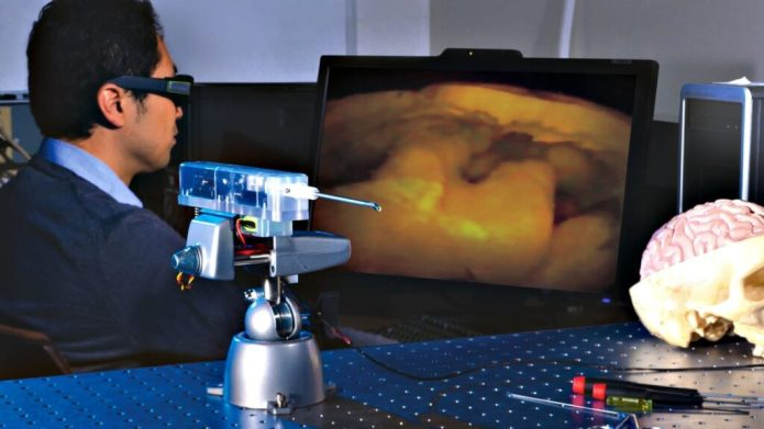 A laboratory prototype of MARVEL, one of the world's smallest 3-D cameras. MARVEL is in the center foreground. On the display is a 3-D image of the interior of a walnut, taken by MARVEL previously, which has characteristics similar to that of a brain. Credit: NASA/JPL-Caltech/Skull Base Institute