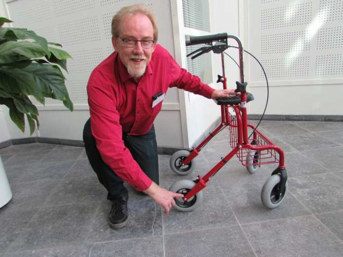 Senior scientist Olli Kuusisto presents the first sensors that have been retrofitted on a rollator.