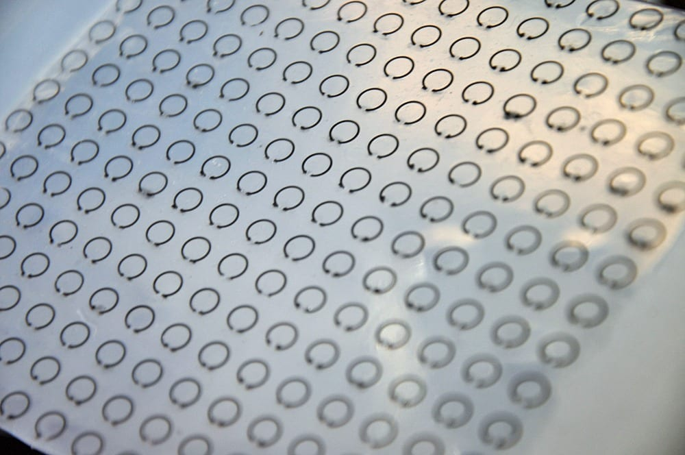 """This flexible, stretchable and tunable """"meta-skin"""" can trap radar waves and cloak objects from detection. Photo courtesy of Liang Dong."""